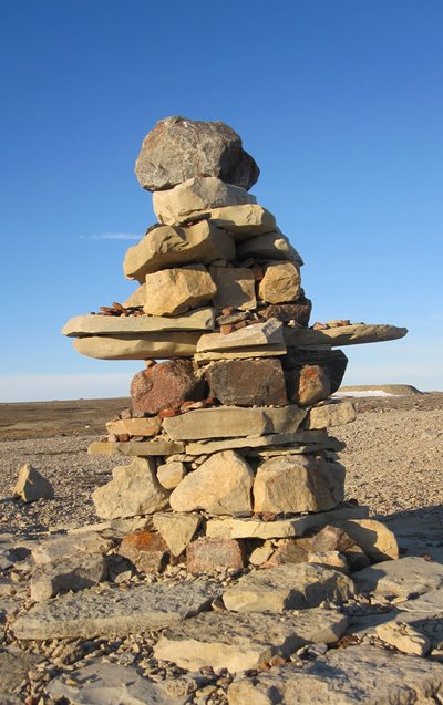 Inuit Art Information-Stone Inukshuk-Igloolik Nunavut-Stone sculpture-Inuit Traditions and Beliefs-Directional Markers-Canada's Arctic-Canadian Arctic Art